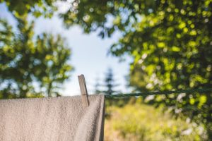 Peg out clothes on the line to dry
